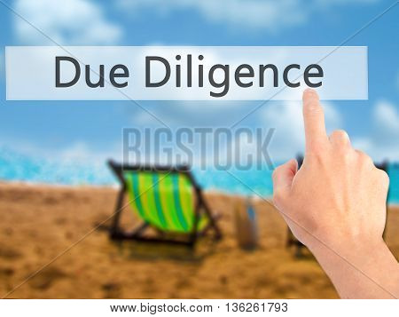 Due Diligence - Hand Pressing A Button On Blurred Background Concept On Visual Screen.