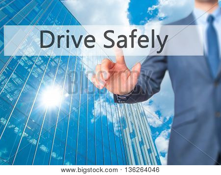 Drive Safely - Businessman Hand Pressing Button On Touch Screen Interface.