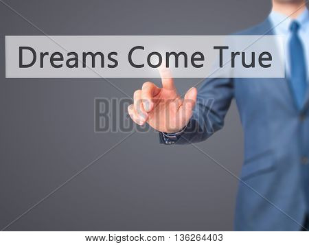 Dreams Come True - Businessman Hand Pressing Button On Touch Screen Interface.