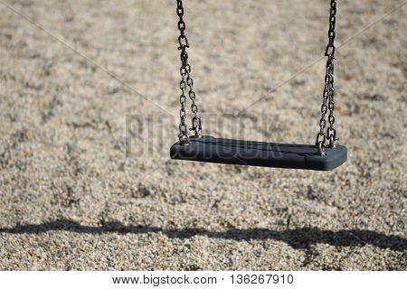 Empty chain swing in playground