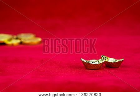 close up  golden ingots on red glossy floor
