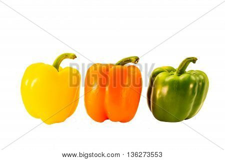 Food sweet peppers in three colors on a white background. Three color sweet paprika A natural beauty Help feed more appetizing. And help build a more prominent feature of the food.