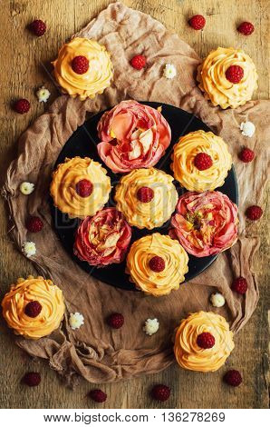Cupcakes On Wooden Table. Homemade Decorated Muffins On The Tab