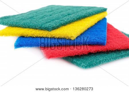 Pan colorful scourers isolated on white background.