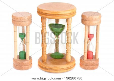 Three hourglasses isolated on a white background.