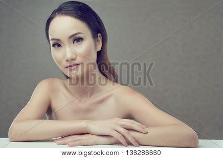 Attractive naked woman with flawless soft skin