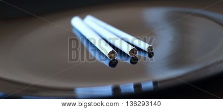 Super slims, slims and king size cigarette closeup isolated