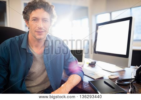 Businessman sitting on a swivel chair in the office