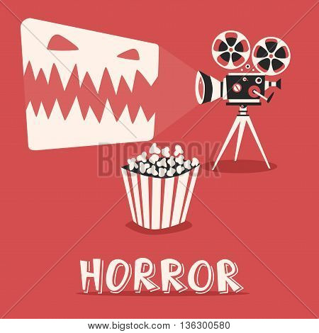 Horror in the cinema. Scary holidays with popcorn. Horrible movie on an old projector