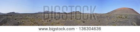 Panoramic view over barren lava landscape of spanish volcanic island Lanzarote