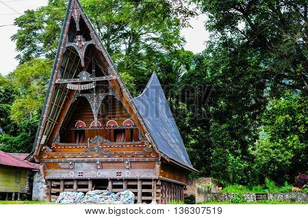 Ethnic traditional Batak House in Toba Lake of Sumatra Indonesia. Batak stands for the ethnic people living in the northern part of Sumatra Island of Indonesia.