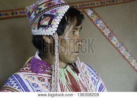 October 22 2012 - Paru Paru Peru: Portrait of a Native Peruvian man wearing handwoven poncho and chullo - knitted hat with earflaps.