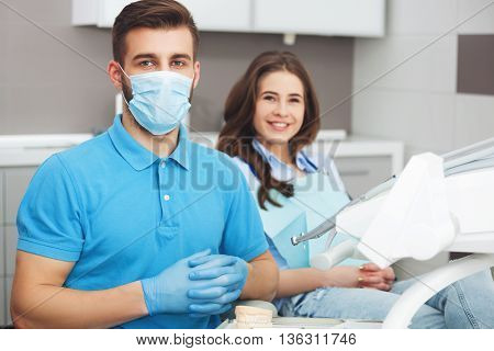 Portrait Of A Male Dentist And Young Happy  Female Patient.
