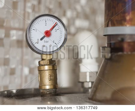water pressure meter closeup photo iin bathroom