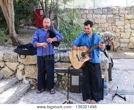 Jerusalem Israel -September 19 2013: street musicians playing in the street on the bagpipes and guitar in Jerusalem Isarel