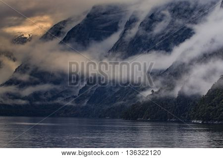 foggy mountain scene in milfordsound fiordland national park soutn island new zealand important traveling desination