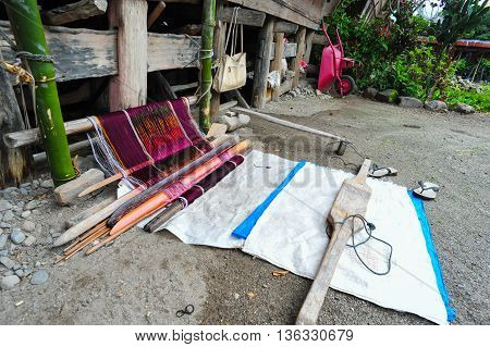 Ethnic Batak ulos weaver in Toba lake of the Samosir Island Sumatra Indonesia. Batak stands for the ethnic people living in the northern part of Sumatra Island of Indonesia.