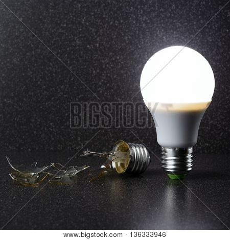 Led Bulb Stands Next To A Broken Incandescent Lamp