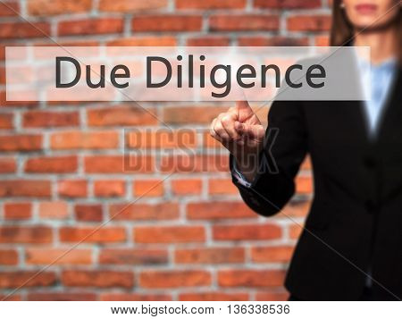 Due Diligence - Businesswoman Hand Pressing Button On Touch Screen Interface.