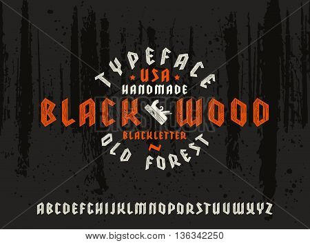 Sanserif font in black letter style decorated wood texture. Gothic typeface on black forest texture background