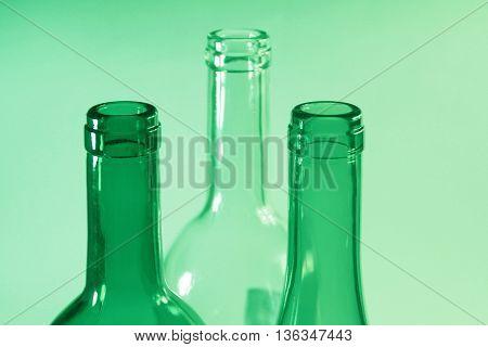 The necks of the glass wine bottles