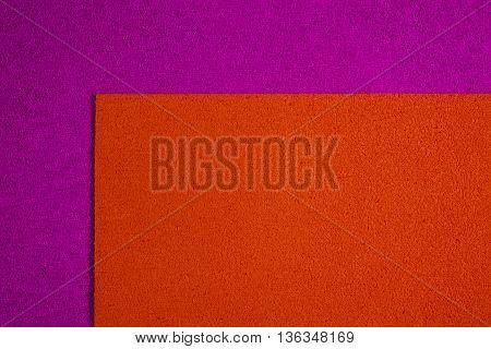 Eva foam ethylene vinyl acetate orange surface on pink sponge plush background