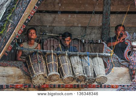 Traditional Batak Musicians performing in Bolon Simanindo Batak Museum Village. Batak stands for the ethnic people living in the northern part of Sumatra Island of Indonesia.