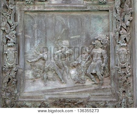 PISA, ITALY - JUNE 06, 2015: Flagellation of Jesus Christ, sculpture work panel from Giambologna's school, right portal panel of the Cathedral St. Mary of the Assumption in Pisa, Italy on June 06,2015