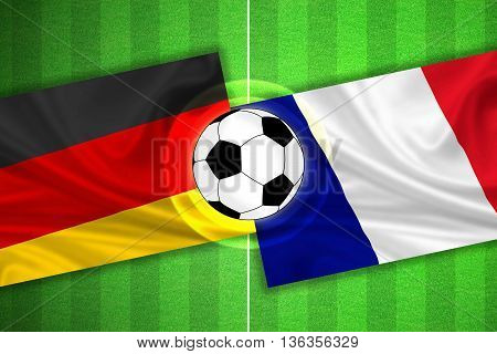 green Soccer / Football field with stripes and flags of germany - france and ball - 3D illustration
