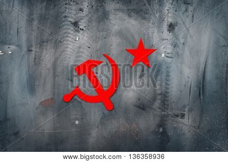 Hammer and sickle. Paper, red, on metal grunge background. Red USSR star.  Copy space.