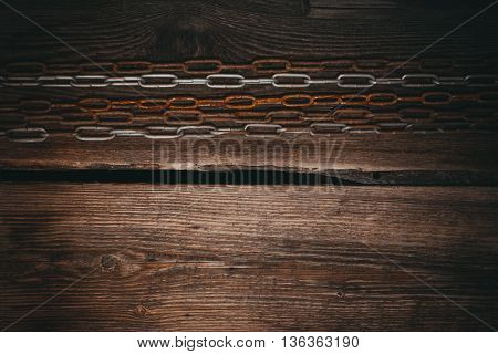 Dark wood board and old metal chain use for background