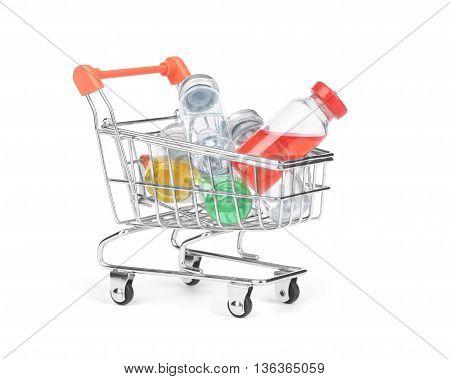 pill bottle in shopping cart trolley  closeup, bargains, remedy,