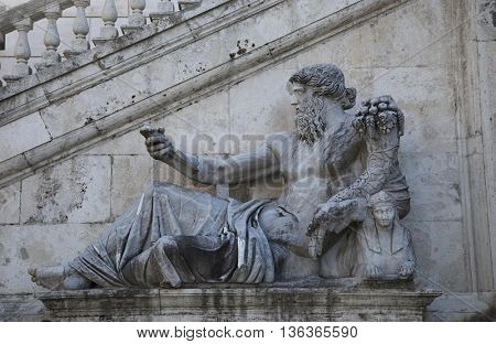 Statue of Tiberius, also known as the river god who found the twins Romulus and Remus and gave them to the she-wolf Lupa