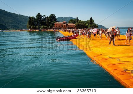 SENSOLE ITALY - JUNE 27: Christo's Floating Piers installation near Isola di San Paolo on June 27th 2016. The bulgarian artist's project connects Montisola and San Paolo island to the mainland using a modular floating dock system covered by yellow fabric.