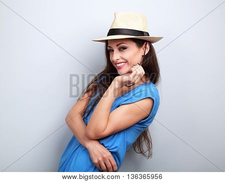 Natural Emotional Laughing Woman Posing In Summer Hat On Blue Background