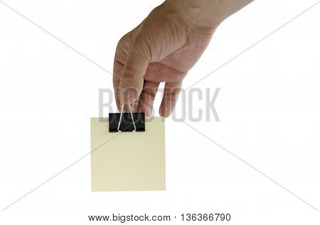 hand with clerical clothespin on white background