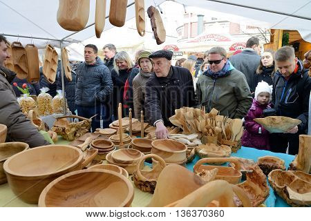 VILNIUS, LITHUANIA - MARCH 7: Unidentified people sell handmade souvenirs from carved wood in annual traditional crafts fair - Kaziuko fair on Mar 7, 2014 in Vilnius, Lithuania