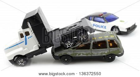 truck collides with car, police present isolated white background