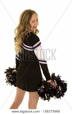 A cheerleader looking over her shoulder she has down syndrome.
