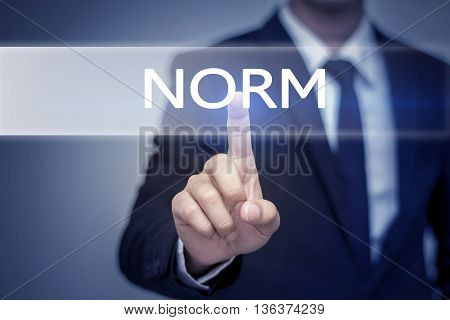 Businessman hand touching NORM button on virtual screen poster