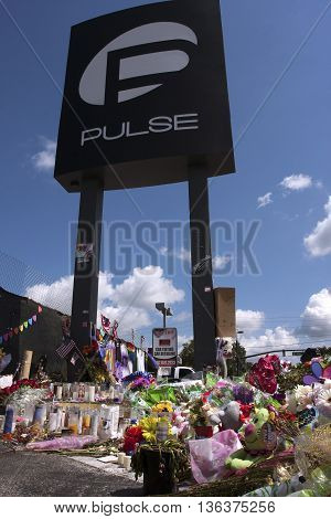ORLANDO, FLORIDA - June 29, 2016: Pulse victim's memorial at the Pulse Night Club on June 29, 2016 in Orlando, Florida.  Flowers and other memorials left at the site of the terrorist attack that killed 49 people.