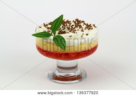 Traditional English strawberry trifle on white background