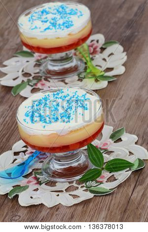 Traditional English trifle dessert with blue sprinkles