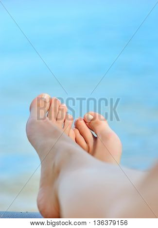 Woman Feet Closeup Of Girl Relaxing On Beach On Sunbed