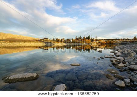 Scenic sunset at Lake Tekapo in the glacier valley in Canterbury, New Zealand during autumn.