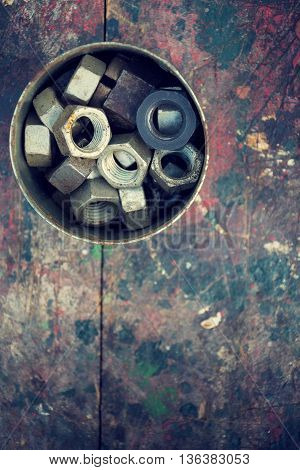 Filtered Nuts In Tin Can On Colorful Wooden Background