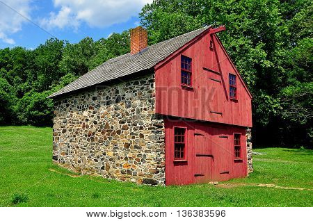 Chadds Ford Pennsylvania - June 9 2015: Fieldstone and wooden work shed at the Gideon Gilpin House in the historic Revolutionary War Brandywine Battlefield Historic Park *