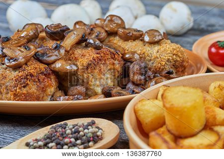 Roasted pork roulades with mushrooms and vegetables