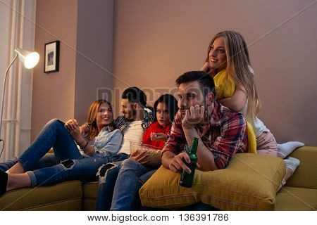 Fiends enjoying movie time together at home.