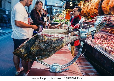Barcelona Spain - May 28 2015. Dry-cured ham called jamon at market called La Boqueria foremost tourist landmarks in Barcelona
